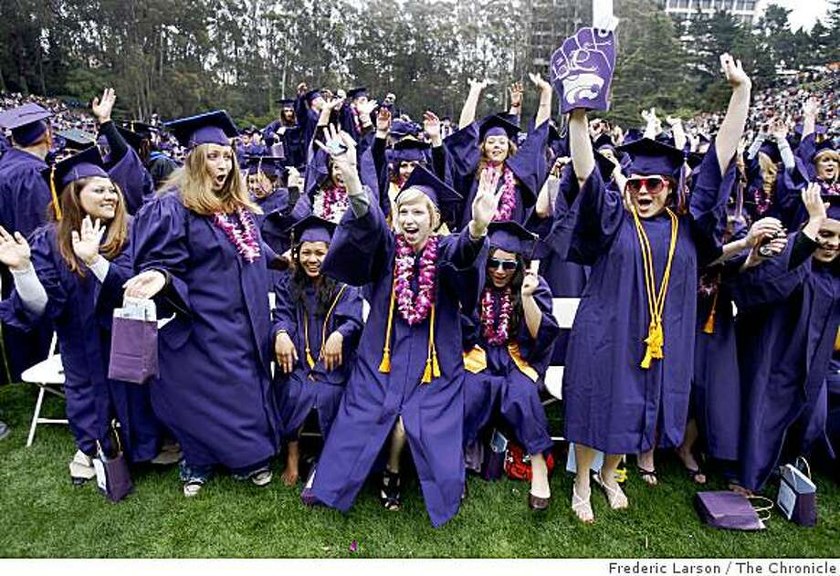 Erica Sanborn (center blond) fires up the crowd of graduates surrounding her at the San Francisco State University which was the biggest ever class at SF State (8,515 students) who got diploma's on May 23, 2009. Photo: Frederic Larson, The Chronicle
