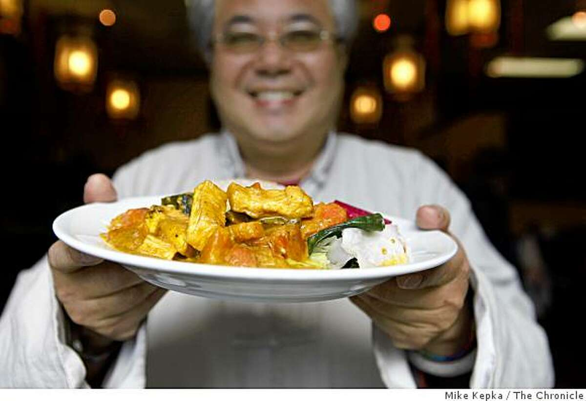 Imperial Tea Court owner Roy Fong, who is leading the charge to use sustainable ingredients in traditional Chinese dim sum, holding Veggie Curry Tofu stands for a picture in his restaurant on Tuesday April 28, 2009 in Berkeley, Calif.