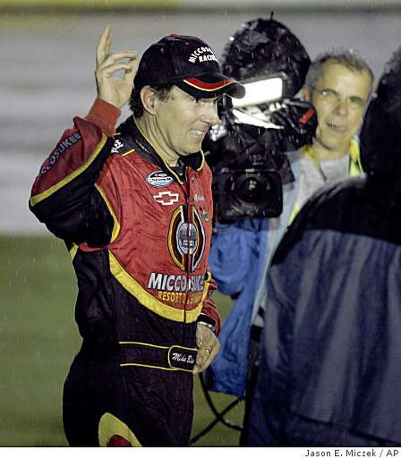 Mike Bliss celebrates after winning the rain-shortened NASCAR Nationwide series Carquest Auto Parts 300 auto race at Lowe's Motor Speedway in Concord, N.C., Saturday, May 23, 2009. (AP Photo/Jason E. Miczek) Photo: Jason E. Miczek, AP