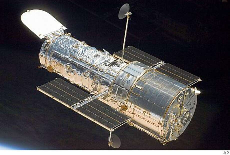 This image provided by NASA shows the Hubble Space Telescope after it's release from the Space Shuttle Atlantis Tuesday May 19, 2009 as the two spacecraft continue their relative separation after having been linked together for the better part of a week. During the week five spacewalks were performed to complete the final servicing mission for the orbital observatory.  (AP Photo/NASA) Photo: AP