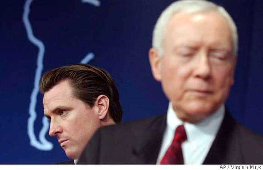 Sen. Orrin Hatch, R-Utah, Chairman of the Senate Judiciary Committee, right, walks away from Mayor of San Francisco Gavin Newsom after a panel discussion 'America's House Divided' at the World Economic Forum in Davos, Switzerland, Friday Jan. 28, 2005. (AP Photo/Virginia Mayo) Ran on: 01-30-2005  Sen. Orrin Hatch of Utah (right) joined San Francisco Mayor Gavin Newsom on a panel at the economic forum in Switzerland. Ran on: 01-30-2005  Sen. Orrin Hatch of Utah (right) joined San Francisco Mayor Gavin Newsom on a panel at the economic forum in Switzerland. Photo: VIRGINIA MAYO