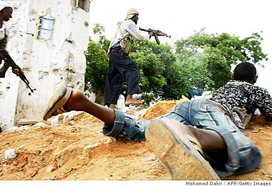 Al-Shabab militiamen fire on Somali government troops in the streets of Somalia's capital, Mogadishu on May 22, 2009. Photo: Mohamed Dahir, AFP/Getty Images