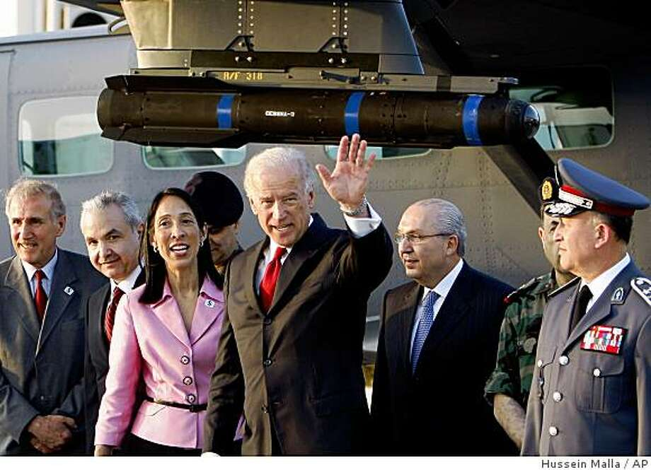 U.S. Vice President Joe Biden, center, waves after reviewing hardware the U.S. has provided to the Lebanese military, as he is accompanied by U.S. Ambassador Michele Sison, third left, Lebanese Defense Minister Elias Murr, second left, and Lebanese police commander Brig. Ashraf Rifi, right, before leaving the country, at Rafik Hariri International Airport in Beirut, Lebanon, Friday, May 22, 2009. Biden reaffirmed strong American support for Lebanon's government Friday as the deeply divided country prepares for crucial elections in two weeks that could see the pro-Western faction ousted by Iranian-backed Hezbollah and its allies. (AP Photo/Hussein Malla) Photo: Hussein Malla, AP