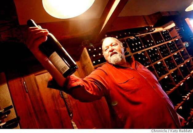 KULETO  Pat Kuleto, restauranteur and winemaker, squints to read a label on a bottle of Zinfandel in his own personal wine cellar at his Kuleto Estate Winery. These pictures were made on Tuesday, Jan. 15, 2008, in St. Helena, CA. KATY RADDATZ/The Chronicle MANDATORY CREDIT FOR PHOTOG AND SAN FRANCISCO CHRONICLE/NO SALES-MAGS OUT Photo: KATY RADDATZ
