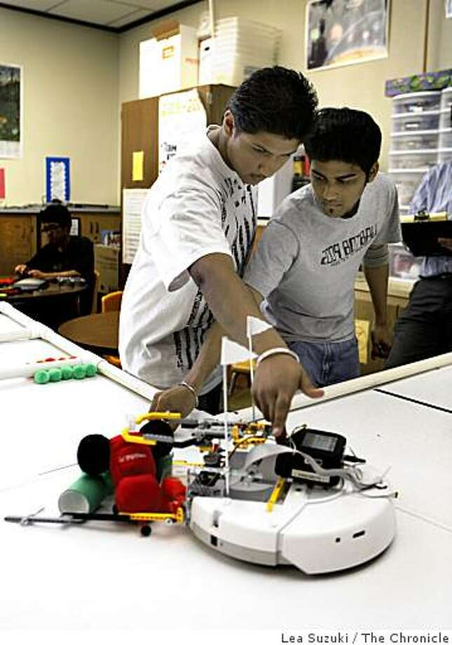 Rohit Krishna, 18 and Oak Grove High School senior and President of the Eaglebots Botball Robotics team (right) and Jaskirat Singh, 16 Oak Grove High School junior (left) , demonstrate their robot on the course  in San Jose, Calif. on Wednesday May 20, 2009. The Eaglebots from Oak Grove High School won the regional championships in a robotics contest and has been invited to compete in the International Botball Robotics Competition in Washington DC June 30 - July 7, 2009. Photo: Lea Suzuki, The Chronicle