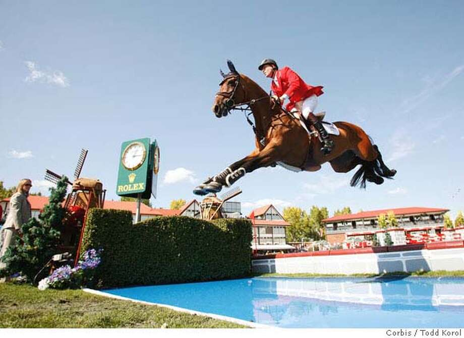 10 Sep 2006, CALGARY, ALBERTA, Canada --- Ian Millar of Canada jumps over the water on In Style at the CN International Open Cup during the Spruce Meadows Masters in Calgary, Alberta, Canada. --- Image by � Todd Korol/Reuters/Corbis Photo: Todd Korol