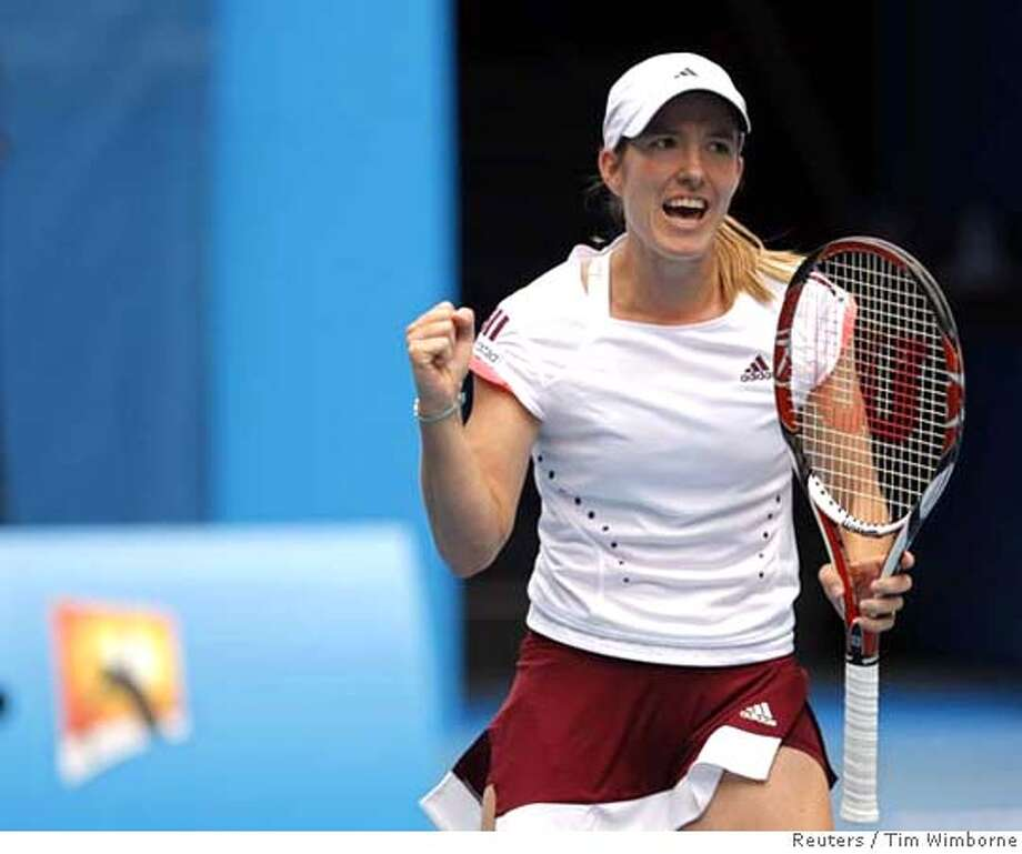 Belgium's Justine Henin pumps her fist during her match against Italy's Francesca Schiavone at the Australian Open tennis tournament in Melbourne January 18, 2008. REUTERS/Tim Wimborne (AUSTRALIA) 0 Photo: TIM WIMBORNE