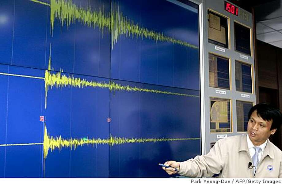 A South Korean meteorological official briefs reporters showing seismic waves from the site of North Korea's nuclear test at his office in Seoul on May 25, 2009.  North Korea said it carried out a second and more powerful nuclear test on May 25, 2009 defying international pressure to rein in its nuclear programmes after years of six-nation disarmament talks.    AFP PHOTO/PARK YEONG-DAE (Photo credit should read PARK YEONG-DAE/AFP/Getty Images) Photo: Park Yeong-Dae, AFP/Getty Images