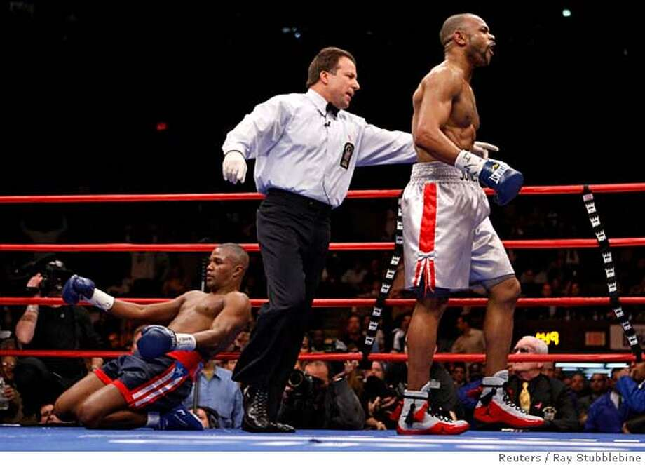 """Roy Jones Jr. is sent to his corner by the referee after knocking down Felix """"Tito"""" Trinidad in the seventh round of their Light Heavyweight boxing match at Madison Square Garden in New York January 19, 2008. REUTERS/Ray Stubblebine (UNITED STATES)  Ran on: 01-20-2008  Roy Jones Jr. knocked down Felix Trinidad here in the seventh round and then again in the 10th to improve to 52-4.  Ran on: 01-20-2008 Photo: RAY STUBBLEBINE"""