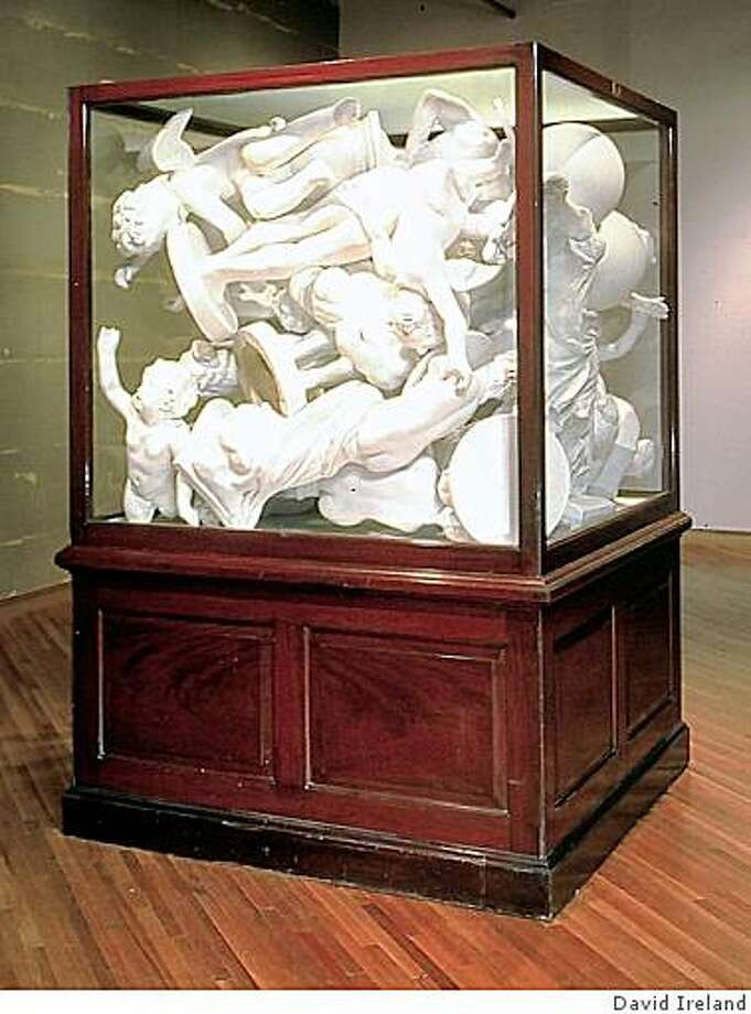 Art by David Ireland. David Ireland retrospective at the Oakland Museum. David Ireland / &quo;Box of Angels,&quo; a pileup of cast plaster angels in a big glass case, turns reverential gestures into pleas for release. Photo: David Ireland