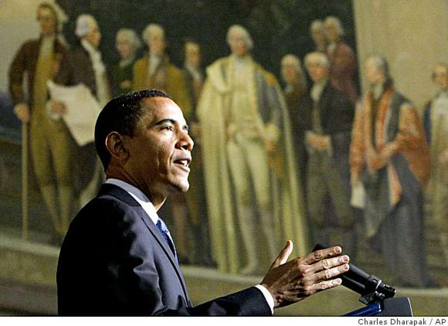 President Barack Obama delivers an address on national security, terrorism, and the closing of Guantanamo Bay prison, Thursday, May 21, 2009 at the National Archives in Washington. Above is a mural painted by Barry Faulkner in 1936 of the Constitution Convention depicting James Madison delivering the final draft of the Constitution to George Washington. (AP Photo/Charles Dharapak) Photo: Charles Dharapak, AP