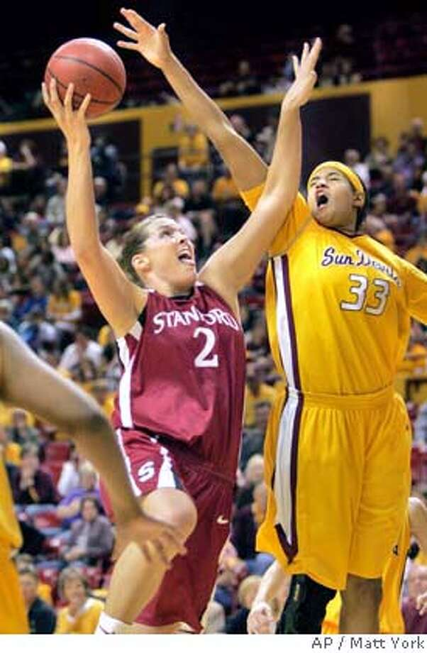 Stanford center Jayne Appel (2) drives to the hoop as Arizona State center Becca Dosty (33) defends during the first half of their college basketball game Sunday, Jan. 20, 2008 in Tempe, Ariz. (AP Photo/Matt York) Photo: Matt York