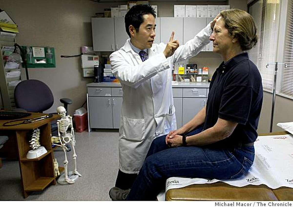 Pain specialist Dr. Michael Leong in his Los Gatos, Ca. office, on Friday May 22, 2009, with one of his patients, Noel Ortiz who has been frustrated in the past with insurers who have denied her pain medications. Noel lives in Twain Harte, Calif.
