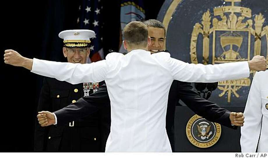 President Barack Obama chest bumps with a graduate during the U.S. Naval Academy graduation and commissioning ceremony, Friday, May 22, 2009, in Annapolis, Md. Photo: Rob Carr, AP
