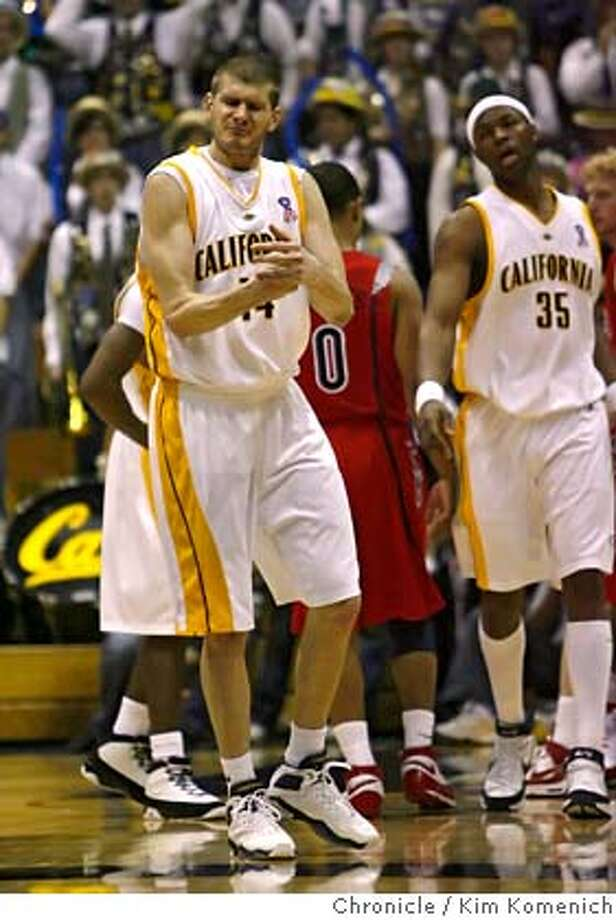Cal's Eric Vierneisel (14) pounds his fist after a key foul in the final minutes that allowed Arizona to gain momentum as Arizona defeats Cal 79-75 at Haas Pavilion in Berkeley Saturday. Cal's DeVon Hardin (35) is in the background.  Photo by Kim Komenich/The Chronicle MANDATORY CREDIT FOR PHOTOG AND SAN FRANCISCO CHRONICLE. NO SALES- MAGS OUT. Photo: KIM KOMENICH