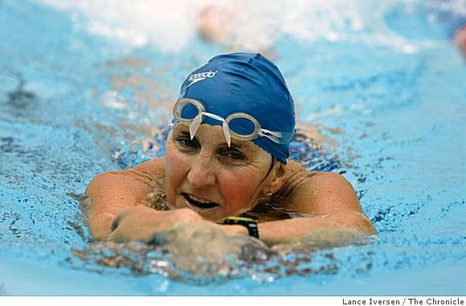 Laura Val, 57, is a Masters Swimmer who often does 100 laps in an Olympic sized pool at Marin Academy using a kick board.  Saturday May 2, 2009. Photo: Lance Iversen, The Chronicle