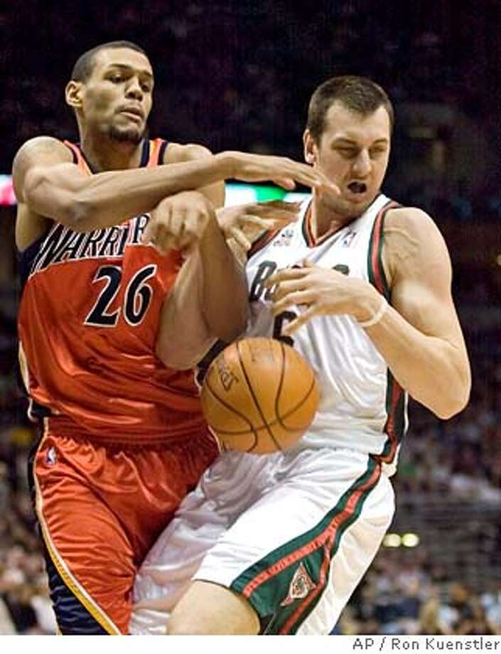 Milwaukee Bucks' Andrew Bogut, right, gets tangled with Golden State Warriors' Patrick O'Bryant during the first quarter of the basketball game, Saturday, Jan. 19, 2008, in Milwaukee, Wis. (AP Photo/ Ron Kuenstler) Photo: Ron Kuenstler