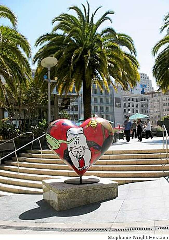 "Artist Terrence K. Stephen painted  ""Love the Animal,"" a heart sculpture, on display at Stockton Street at Post. Photo: Stephanie Wright Hession"