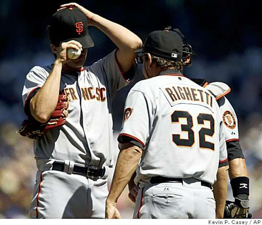 San Francisco Giants' pitcher Barry Zito, left, talks with catcher Eli Whiteside, behind, and pitching coach Dave Righetti (32) during the fourth inning of a baseball game against the Seattle Mariners in Seattle on Sunday, May 24, 2009. Seattle defeated San Francisco 5-4. (AP Photo/Kevin P. Casey) Photo: Kevin P. Casey, AP