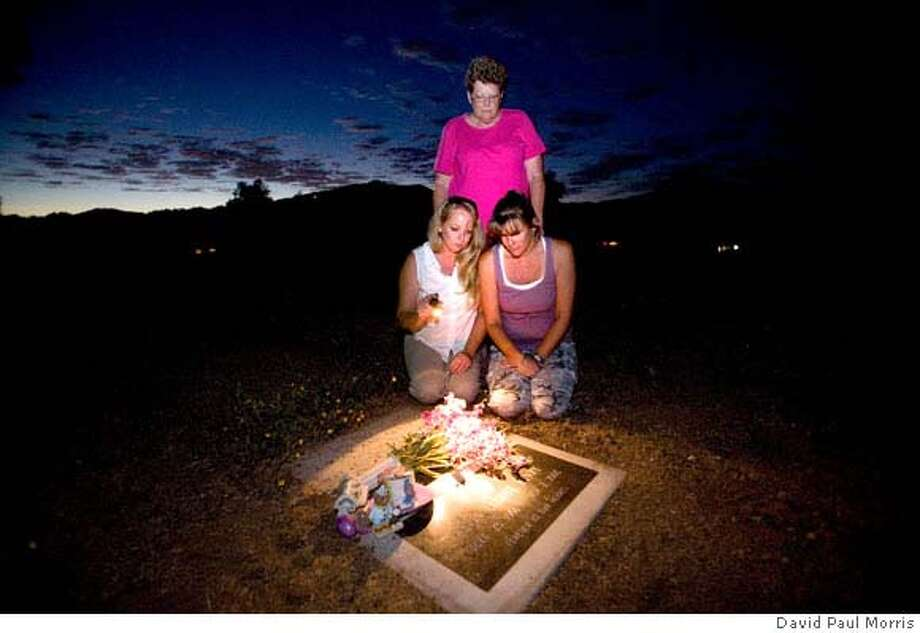 UPPER LAKE, CA: Rachelle Henry, Barbie Lizama and Laura Denman vist the grave of Kevin Henry on August 30, 2007 in Upper Lake, California. (Photograph by David Paul Morris) Photo: David Paul Morris