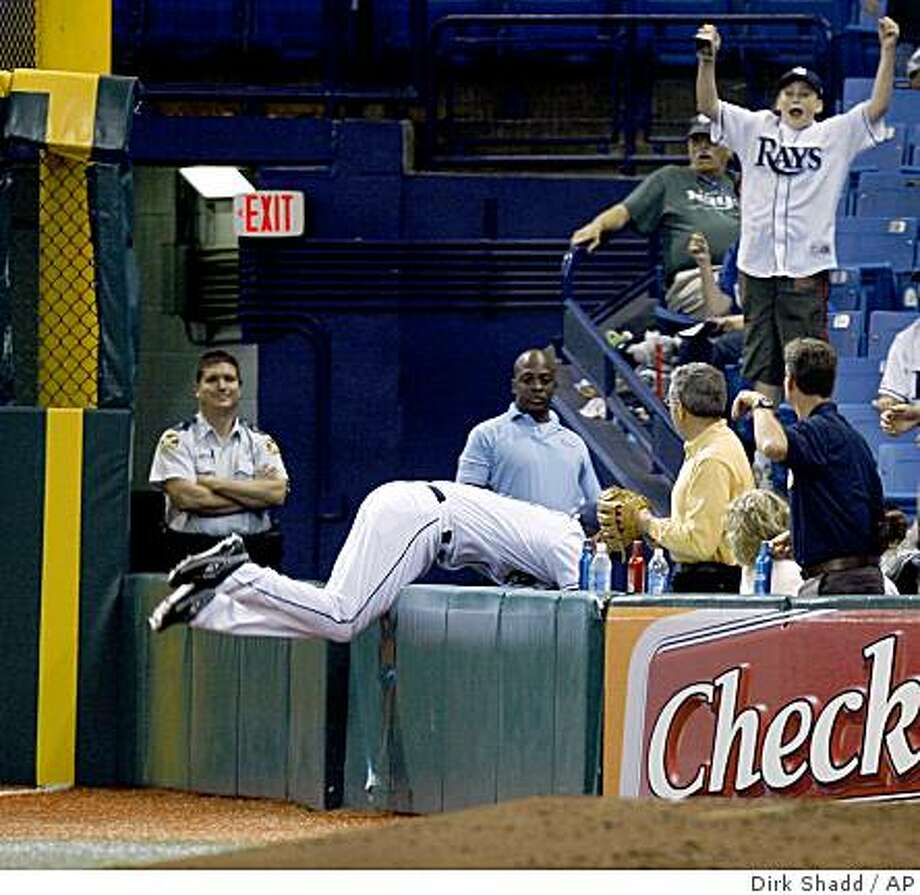 Tampa Bay Rays right fielder Ben Zobrist makes a catch at the right field foul pole wall as he flips into the seats to get the final out to end the sixth inning against the Oakland Athletics at Tropicana Field in St. Petersburg, Fla., Monday, May 18, 2009. (AP Photo/St. Petersburg Times, Dirk Shadd) ** TAMPA OUT; CITRUS COUNTY OUT; PORT CHARLOTTE OUT; BROOKSVILLE HERNANDO TODAY OUT; USA TODAY OUT; MAGS OUT; NO SALES ** Photo: Dirk Shadd, AP
