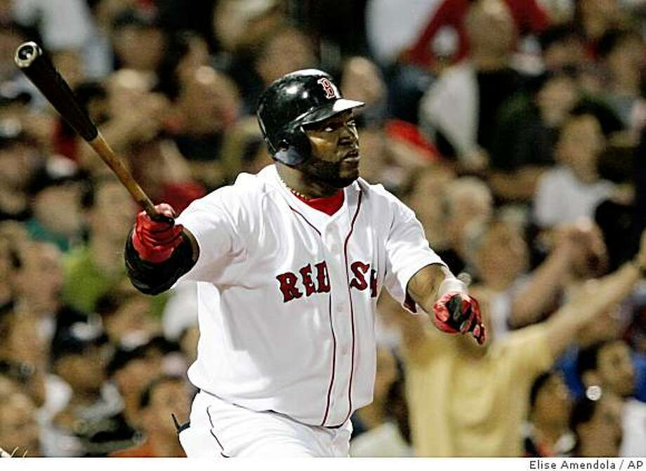 Boston Red Sox's David Ortiz watches his two-run homer off Toronto Blue Jays pitcher Brett Cecil in the fifth inning of a baseball game at Fenway Park in Boston on Wednesday, May 20, 2009. (AP Photo/Elise Amendola) Photo: Elise Amendola, AP
