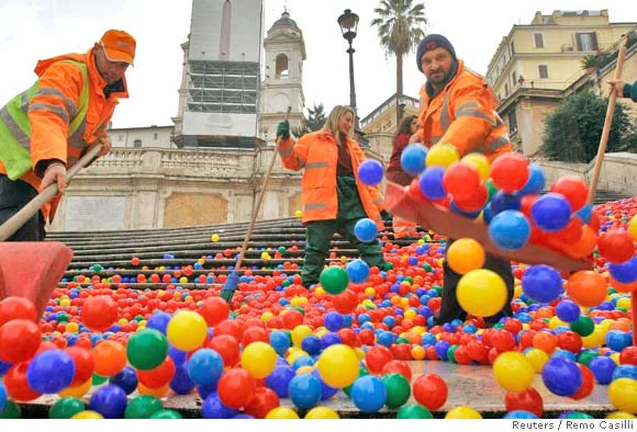 Workers remove plastic balls which were released by an artist down the Spanish Steps, in Rome January 16, 2008. Graziano Cecchini, who calls himself an artistic activist, claimed to Italy's ANSA news agency that he released the balls from the top of Rome's Spanish Steps to highlight the nation's problems. REUTERS/Remo Casilli (ITALY) Photo: STRINGER/ITALY
