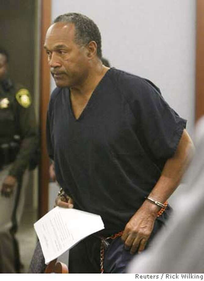 O.J. Simpson, former football great, appears in court for violating terms of his bail in Clark County District Court in Las Vegas January 16, 2008. Simpson's trial is scheduled for April 7. REUTERS/Rick Wilking (UNITED STATES) Photo: RICK WILKING