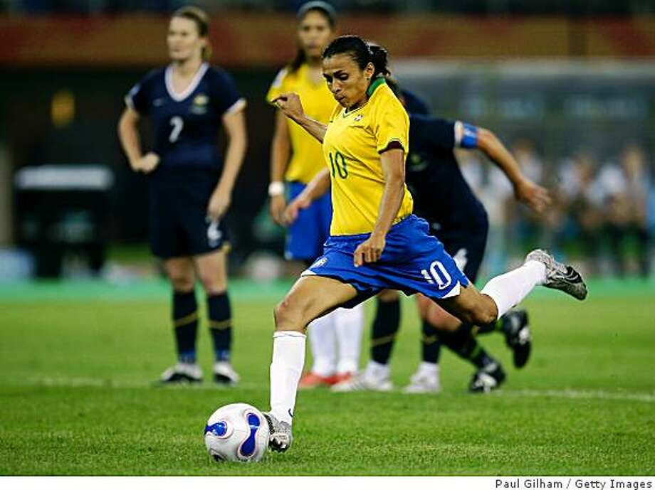 TIANJIN, CHINA - SEPTEMBER 23:  Marta Vieira Da Silva scores a penalty and the second goal for Brazil during the Quarter Final of the Women's World Cup 2007 match between Brasil and Australia at Tianjin Olympic Center Stadium on September 23, 2007 in Tianjin, China.  (Photo by Paul Gilham/Getty Images) Photo: Paul Gilham, Getty Images