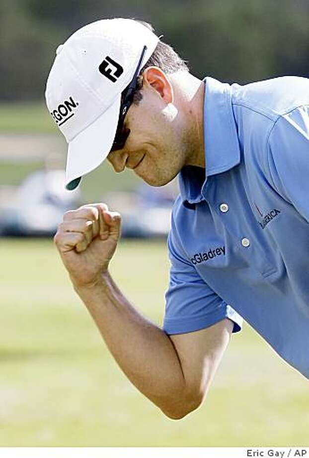 Zach Johnson, of Cedar Rapids, Iowa, reacts as he makes a birdie putt to win the Texas Open golf tournament in San Antonio, Sunday, May 17, 2009. Johnson defeated James Driscoll in the first hole of a playoff. (AP Photo/Eric Gay) Photo: Eric Gay, AP