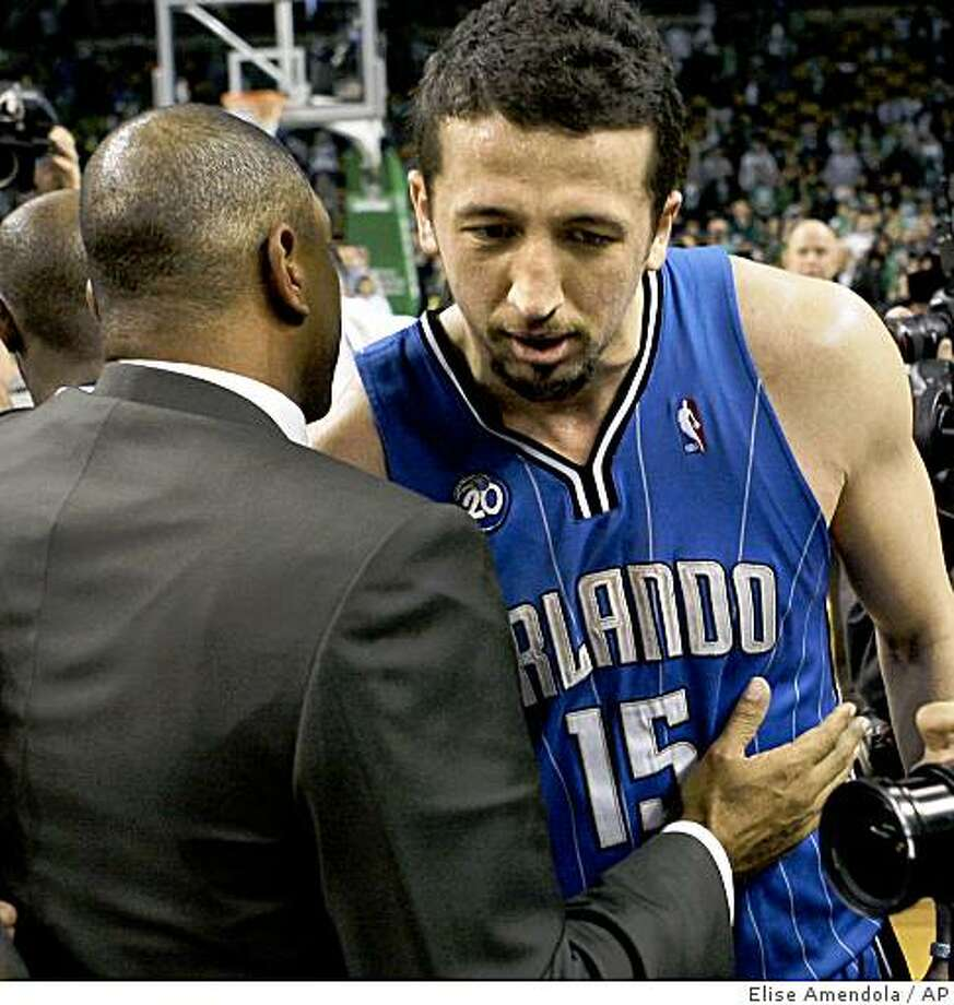 Orlando Magic's Hedo Turkoglu (15), of Turkey, listens to Boston Celtics coach Doc Rivers as Turkoglu leaves the court after the Magic beat the Celtics 101-82 in Game 7 of the NBA basketball Eastern Conference semifinal playoff series in Boston on Sunday, May 17, 2009. The Magic will face the Cleveland Cavaliers in the conference finals. (AP Photo/Elise Amendola) Photo: Elise Amendola, AP