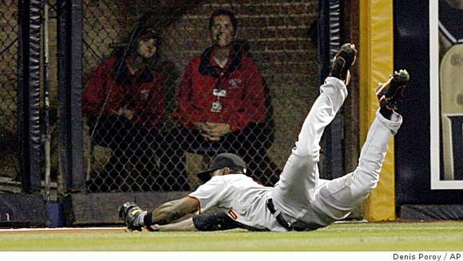San Francisco Giants left fielder Fred Lewis dives as he makes the catch on a ball hit by the San Diego Padres' David Eckstein during the seventh inning of a baseball game Tuesday, May 19, 2009, in San Diego.  (AP Photo/Denis Poroy) Photo: Denis Poroy, AP
