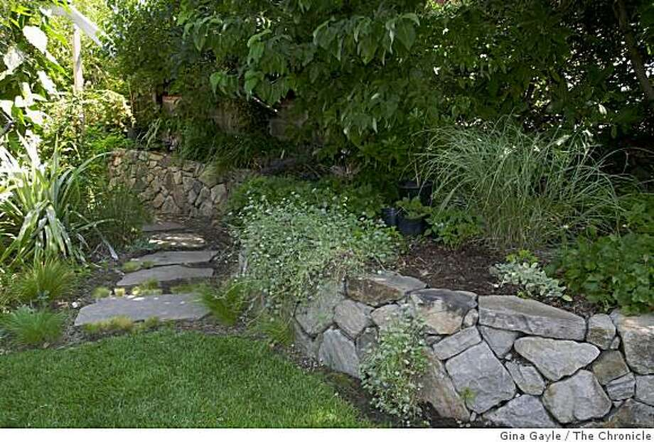 -A wall of stone adorns the Mediterranean garden created by landscape architect Phil Johnson for his own home in Walnut Creek. Photo by Gina Gayle/The SF Chronicle. Photo: Gina Gayle, The Chronicle