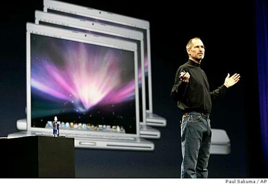 Apple CEO Steve Jobs gestures during his keynote at the MacWorld Conference in San Francisco, Tuesday, Jan. 15, 2008. (AP Photo/Paul Sakuma) Photo: Paul Sakuma, AP