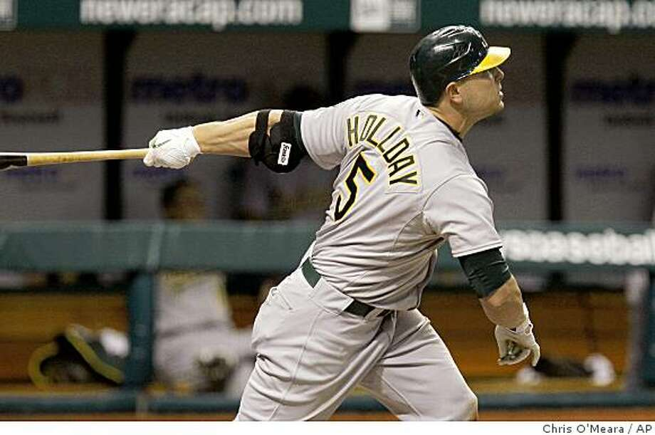 Oakland Athletics' Matt Holliday follows the flight of his 11th inning three-run home run off Tampa Bay Rays pitcher Joe Nelson during a baseball game, Tuesday in St. Petersburg, Fla. Athletics' Kurt Suzuki and Jack Cust also scored on the hit. Photo: Chris O'Meara, AP