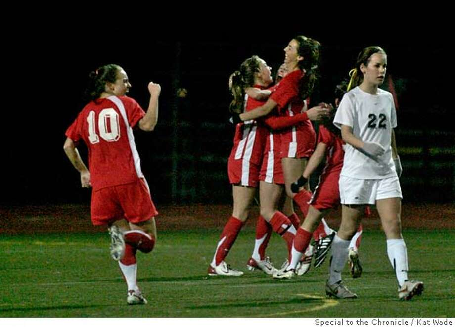 SOCCER_0383_KW.JPG  The Mustang's Camellia Senemar (17, right) hugs teammate Courtney Jones (14, center) while Amanda Owens (10, left) throws a celebratory fist in the air after Jones scored the winning goal of the game in the final minute. The top-ranked soccer team, the Monte Vista High School Mustangs beat the San Ramon Valley High School Wolves 2 to 1on Tuesday, January 15, 2008 in Danville, Calif. at San Ramon Valley High School. Kat Wade/Special to the Chronicle  (CQ, Subject) Mandatory Credit for photographer, Kat Wade No Sales/Mags out Photo: Kat Wade