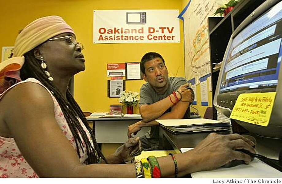 Phavia Kujichagulia( left) and Carl Singh talk about the help calls that they have received from residents in Oakland about the digital conversion,  Wed. May 14, 2009, at the DTV assistance center in Oakland, Calif. Photo: Lacy Atkins, The Chronicle