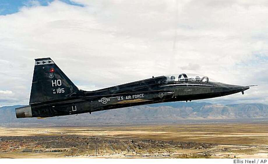 FILE - In this Feb. 23, 2006 file photo, a T-38 Talon gains altitude over Holloman Air Force Base, N.M. A military jet on a training mission crashed north of Edwards Air Force base in the desert on Thursday May 21, 2009 authorities said. The fate of the two crew members aboard was not immediately known. (AP Photo/Alamgoordo Daily News, Ellis Neel) Photo: Ellis Neel, AP