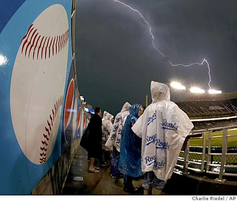Fans wait at Kauffman Stadium during a rain delay in a baseball game between the Kansas City Royals and the Baltimore Orioles Friday, May 15, 2009, in Kansas City, Mo. Baltimore won the game 9-5. (AP Photo/Charlie Riedel) Photo: Charlie Riedel, AP
