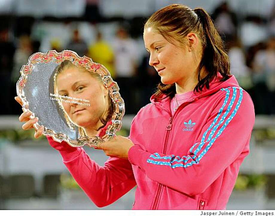 MADRID, SPAIN - MAY 17:  Dinara Safina of Russia holds the winners trophy after her straight set victory against Caroline Wozniacki of Denmark during the final of the Madrid Open tennis tournament at the Caja Magica on May 17, 2009 in Madrid, Spain. Safina won the match in two sets, 6-2 and 6-4.  (Photo by Jasper Juinen/Getty Images) Photo: Jasper Juinen, Getty Images