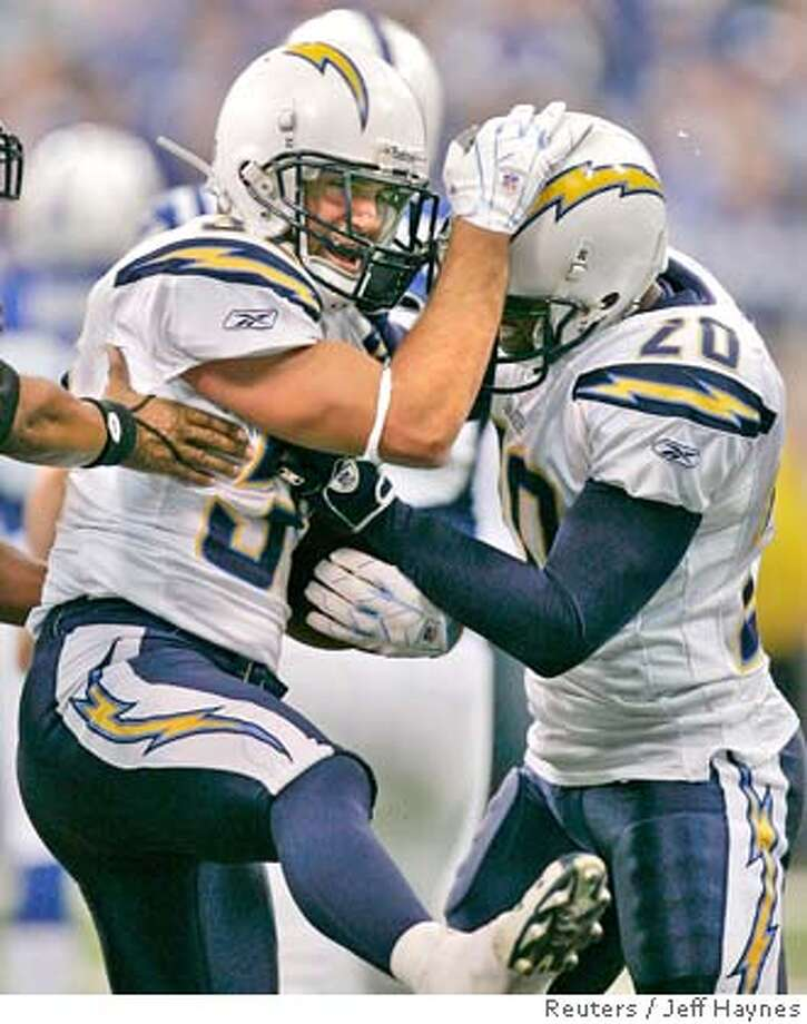 San Diego Chargers' Eric Weddle (L) celebrates his interception with Marlon McCree during the third quarter of their AFC Divisional NFL playoff football game against the Indianapolis Colts in Indianapolis, Indiana, January 13, 2008. REUTERS/Jeff Haynes (UNITED STATES) Photo: JEFF HAYNES