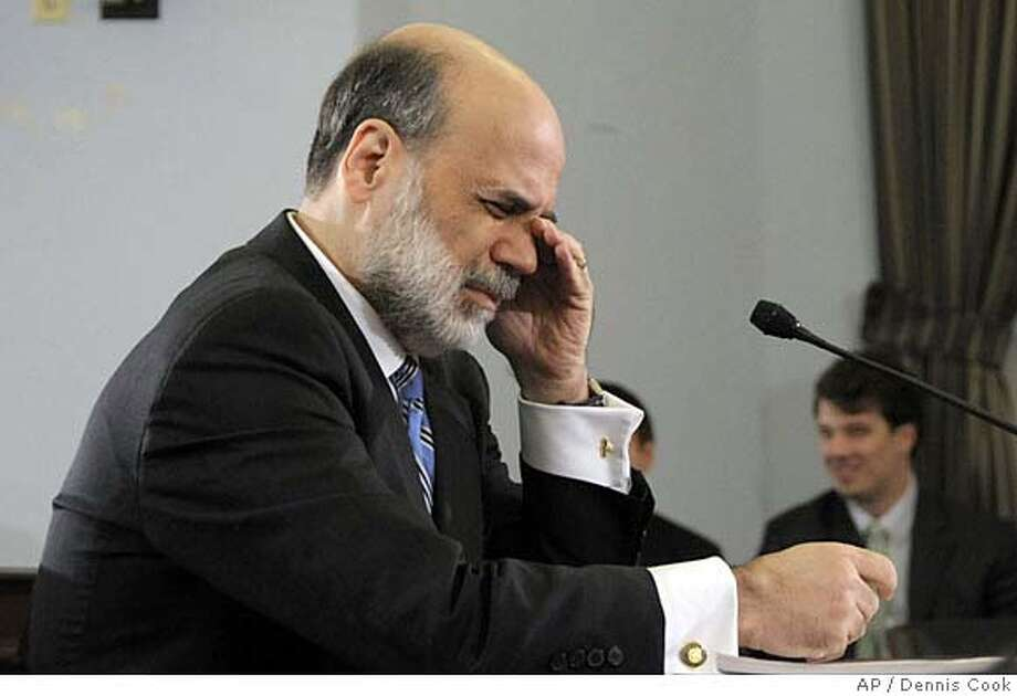 Federal Reserve Board Chairman Ben Bernanke pauses while discussing the near-term economic outlook during testimony on Capitol Hill in Washington, Thursday, Jan. 17, 2008, before the House Budget Committee. (AP Photo/Dennis Cook) Photo: Dennis Cook