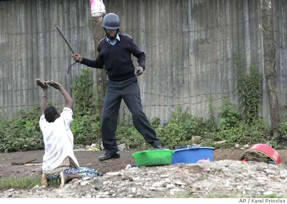 A woman who wa washing her laundry when police fired tear gas, begs a policeman not to beat her, Thursday, Jan. 17, 2008, during clashes in the Mathare slum neighborhood in Nairobi. Machete-wielding residents hurled stones at police who fired tear gas and gunshots on a second day of opposition protests Thursday. Across most of the edgy East African nation, though, demonstrations appeared to be losing steam.(AP Photo/Karel Prinsloo) Photo: KAREL PRINSLOO