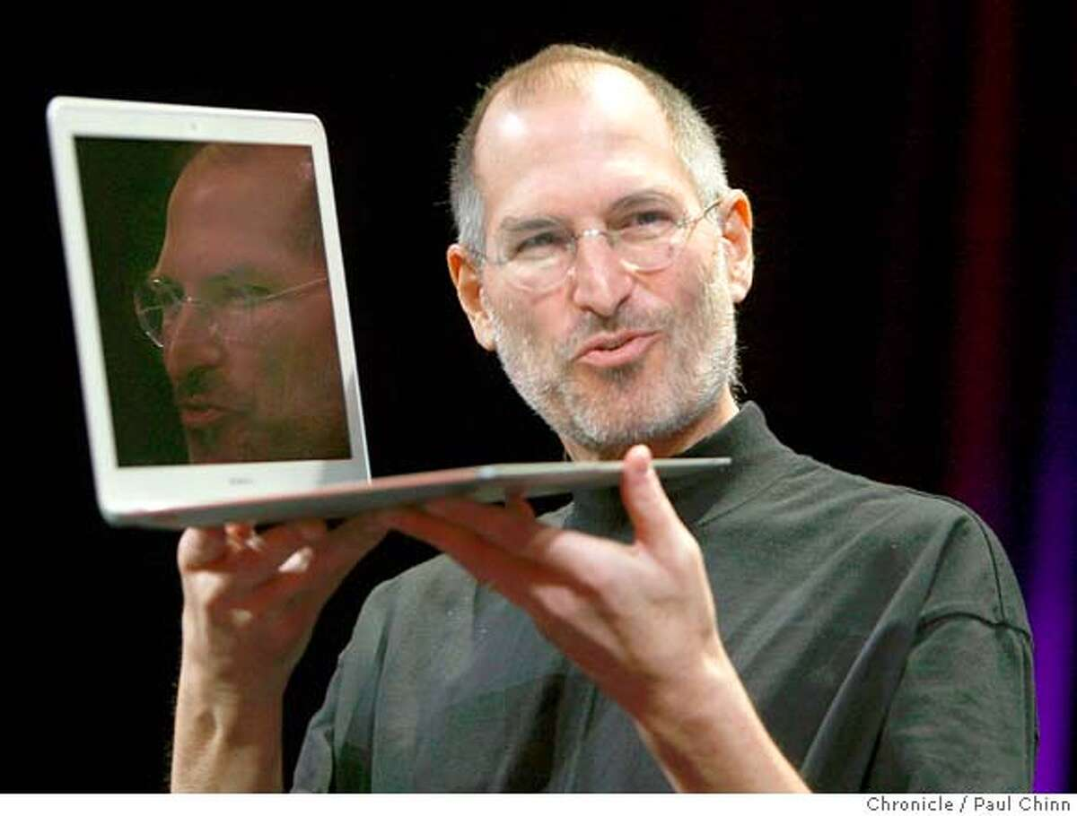 Apple CEO Steve Jobs shows off the ultra-thin MacBook Air during his keynote address to open the annual Macworld conference in San Francisco, Calif. on Tuesday, Jan. 15, 2008. Jobs announced upgrades to the iPhone and iTouch and introduced the new MacBook Air and Time Capsule.