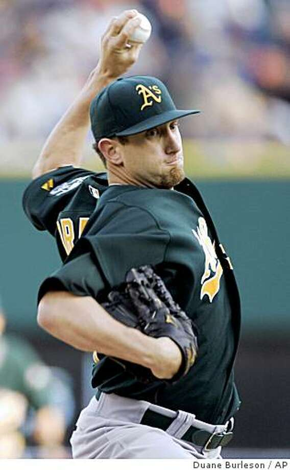 Oakland Athletics starter Dallas Braden pitches against the Detroit Tigers in the first inning of a baseball game Saturday, May 16, 2009, in Detroit. (AP Photo/Duane Burleson) Photo: Duane Burleson, AP