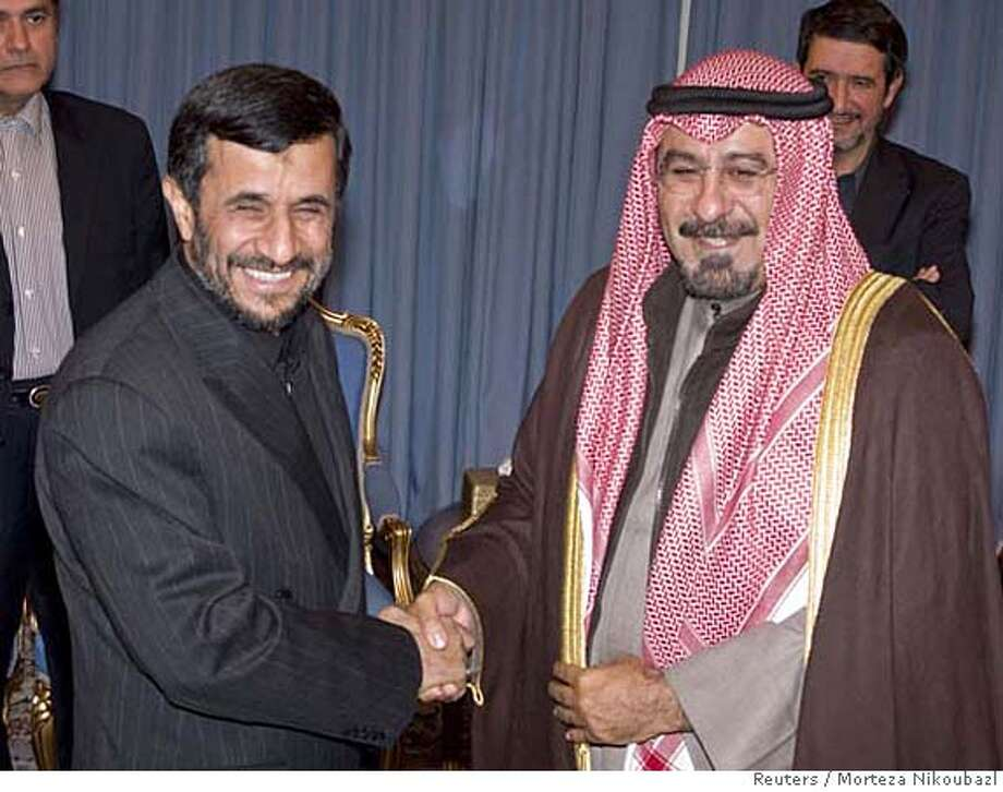 Iran's President Mahmoud Ahmadinejad (L) shakes hands with Kuwait's Foreign Minister Sheikh Mohammed al-Sabah during an official meeting in Tehran January 16, 2008. REUTERS/Morteza Nikoubazl (IRAN) 0 Photo: MORTEZA NIKOUBAZL