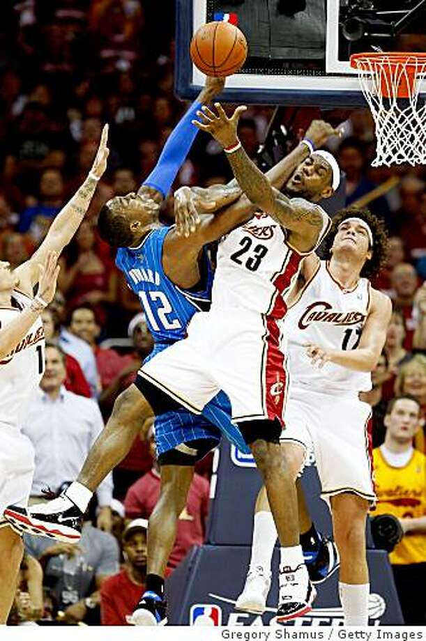 LeBron James #23 of the Cleveland Cavaliers contests the shot of Dwight Howard #12 of the Orlando Magic in Game One of the Eastern Conference Finals during the 2009 Playoffs at Quicken Loans Arena on May 20, 2009 in Cleveland, Ohio. Photo: Gregory Shamus, Getty Images