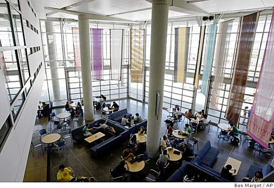 Merced students lounge in the 'lantern', a meeting place at the heart of campus in Merced, Calif., Monday, April 20, 2009. Two years ago, the University of California, Merced couldn't attract enough students to fill its classrooms. Now, the 430 members of its first full senior class have wooed first lady Michelle Obama to give their graduation speech, a major win for a school considered the poor step-child of the state system.  (AP Photo/Ben Margot) Photo: Ben Margot, AP