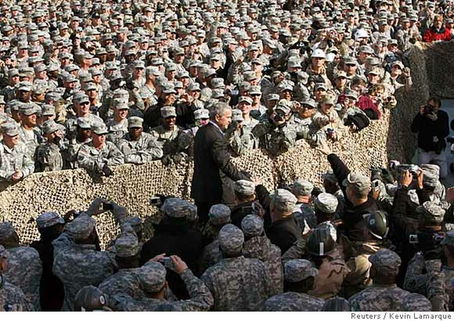 President Bush arrives at Camp Arifjan in Kuwait to speak to American troops. Reuters photo by Kevin Lamarque