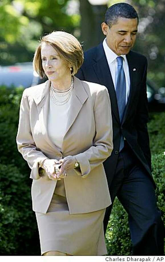 President Barack Obama walks with House Speaker Nancy Pelosi of Calif. to an event in the Rose Garden of the White House in Washington, Tuesday, May 19, 2009, to announce new fuel and emission standards for cars and trucks. (AP Photo/Charles Dharapak) Photo: Charles Dharapak, AP